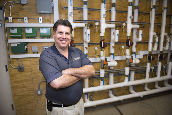 Dan Foley of Foley Mechanical in the mechanical room in the newly renovated Wormley School building.